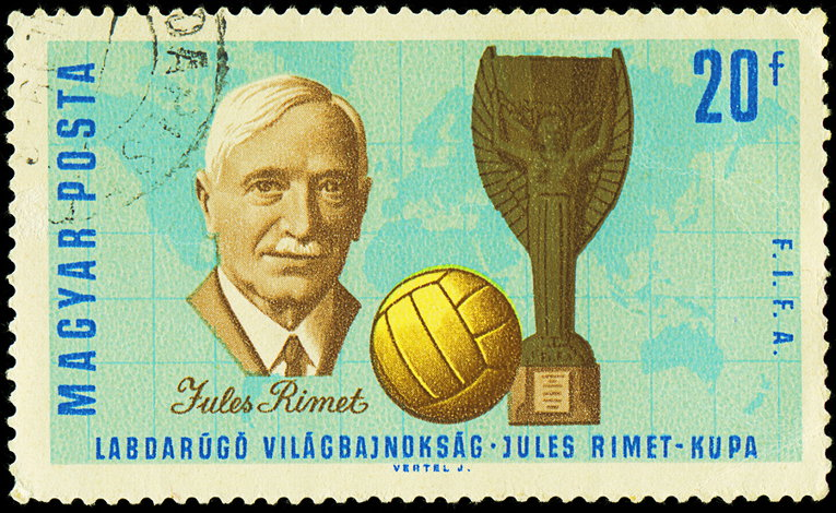 jules rimet and original world cup on a stamp