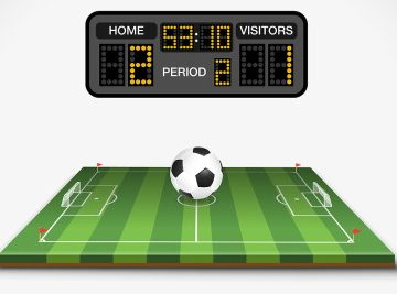 football pitch with scoreboard above