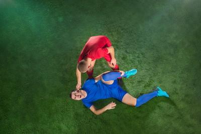 football player lying injured