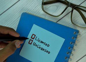 licensed unlicensed tick boxes on notebook