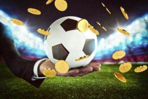 man holding football money raining down